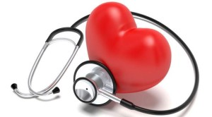 Love your heart as part of your cholesterol management - a three dimensional silicone red heart with a stethascope wrapped around indicating heart health and cholestrol go hand in hand